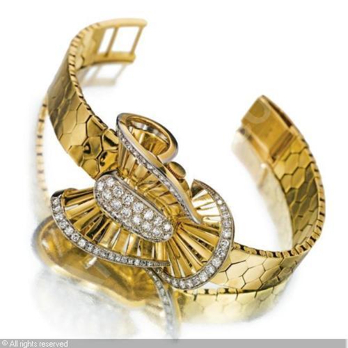 Name:  rolex-switzerland-a-lady-s-gold-diamond-set-brac-2259040.jpg Views: 61 Size:  33.8 KB